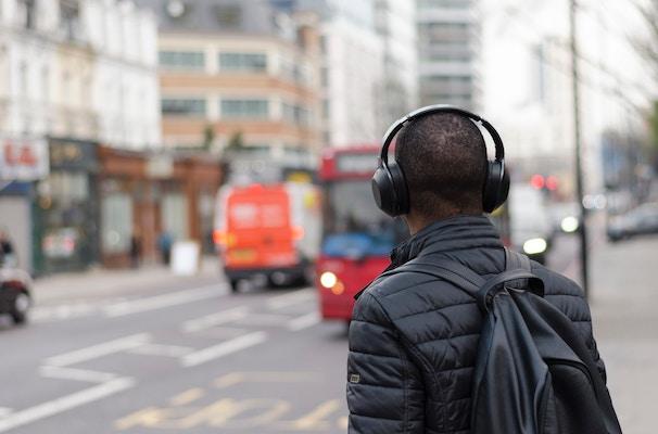 man listening with headphones